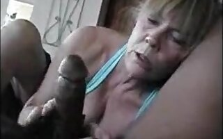 This older lady really love to suck black dick