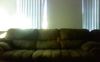 Voyeur black guy makes a sextape with the gf on the sofa