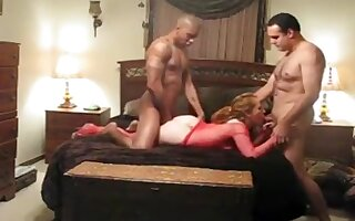 Two ripped men share a naughty kinky slut in the b...
