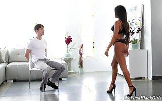 Elegant raven goddess restraints her man to a chair before shafting him