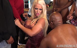 Bomb ass cougar Alura Jenson is fucked by a handful of frowning guys